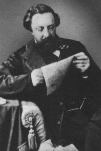 Фотография А.К. Толстого за чтением